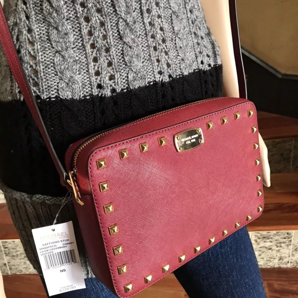 57ea256ce4daf4 Michael Kors East West Studded Cherry Saffiano Leather Cross Body Bag -  Tradesy