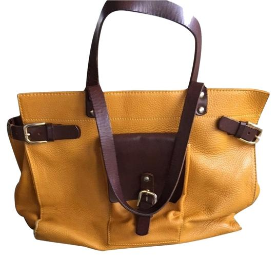 Preload https://item2.tradesy.com/images/mustard-and-brown-leather-tote-2297136-0-0.jpg?width=440&height=440