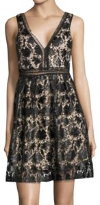 Romeo & Juliet Couture V Neck Front V Neck Lined Crochet Lace Glistening Lace Dress