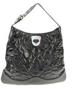 fb75caa924c2 Alexander McQueen Patent Leather Floral Embossed Hobo Bag