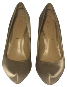 BCBGMAXAZRIA Gold Pumps
