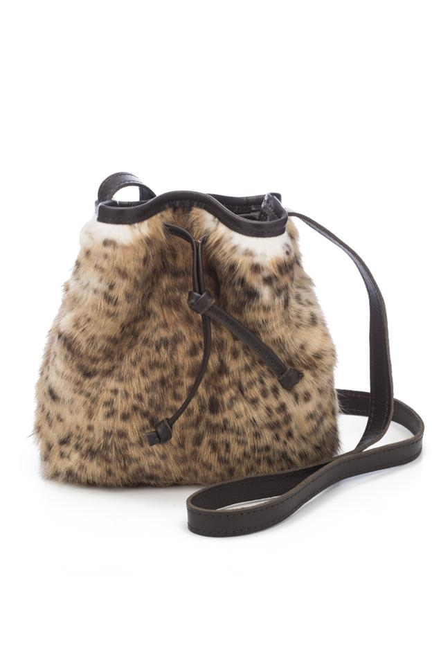 55fc7f66c4 Free People Bucket The Colonia - Fluffy Cheetah Camel Leather Cross Body  Bag 58% off retail