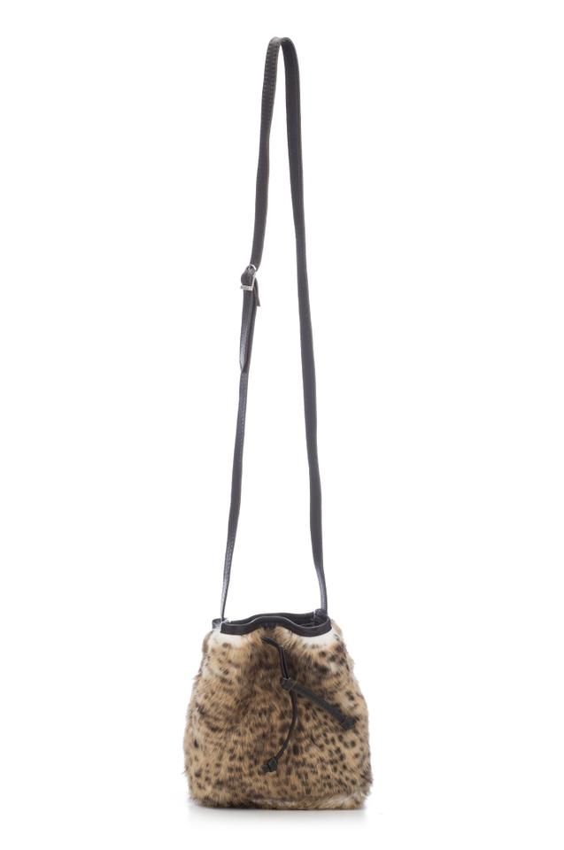 Free People The Colonia Bucket - Fluffy Cheetah Camel Leather Cross ... 528c9d3e80a17