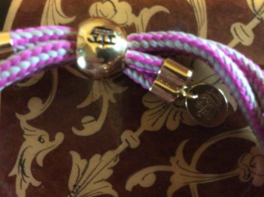 Juicy Couture Juicy Couture expandable rope type bracelet with gold accents and large pink stone