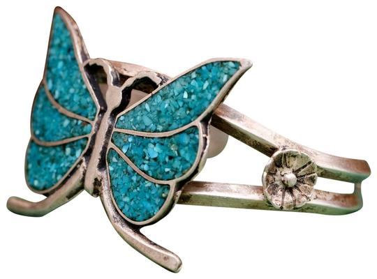 Preload https://img-static.tradesy.com/item/22993143/turquoise-and-silver-native-sterling-butterfly-floral-cuff-flower-bracelet-0-16-540-540.jpg