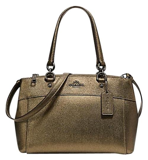 Preload https://img-static.tradesy.com/item/22993304/coach-christie-mini-brooke-carryall-f25928-57523-gold-leather-satchel-0-1-540-540.jpg