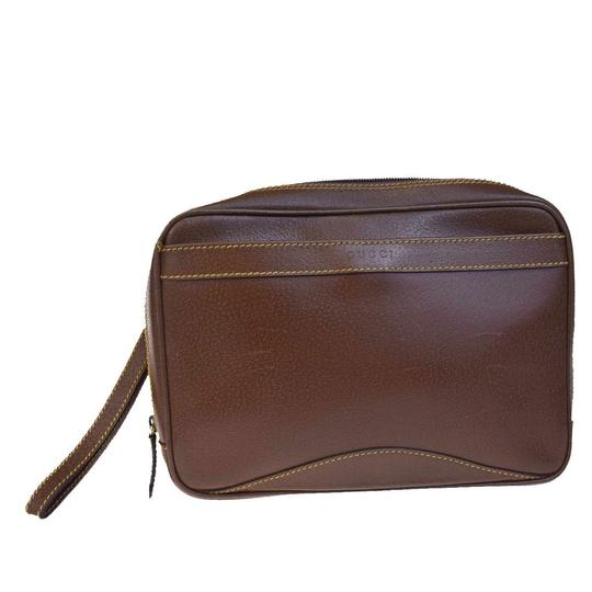 Preload https://img-static.tradesy.com/item/22993626/gucci-logos-hand-in-italy-brown-leather-clutch-0-0-540-540.jpg