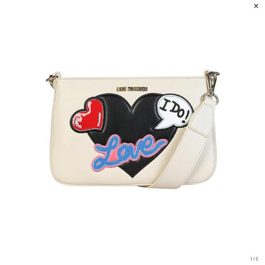 Preload https://img-static.tradesy.com/item/22994219/love-moschino-white-synthetic-leather-clutch-0-0-540-540.jpg