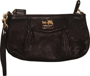 Coach Wristlet in black with gold