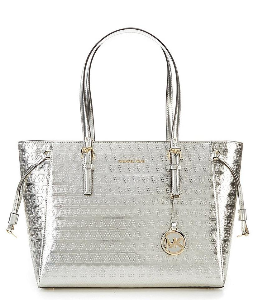 87490521a05a MICHAEL Michael Kors Voyager Specchio Multi-function Medium Leather Tote in  Champagne Image 0 ...