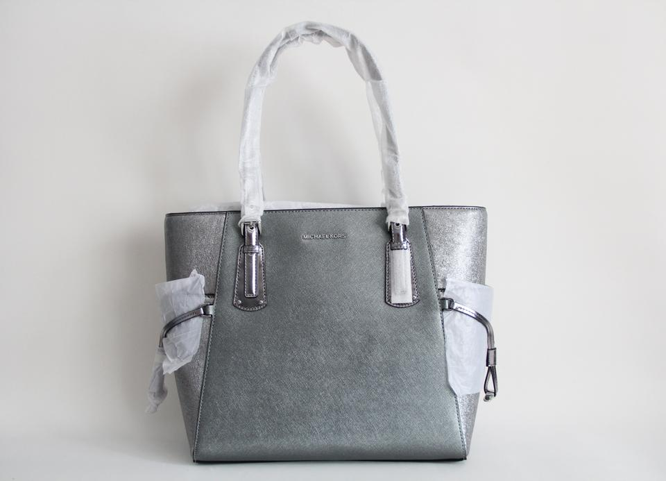 36b8d452b79e Michael Kors Leather Voyager Leather Silver Tote in Light Pewter Image 9.  12345678910