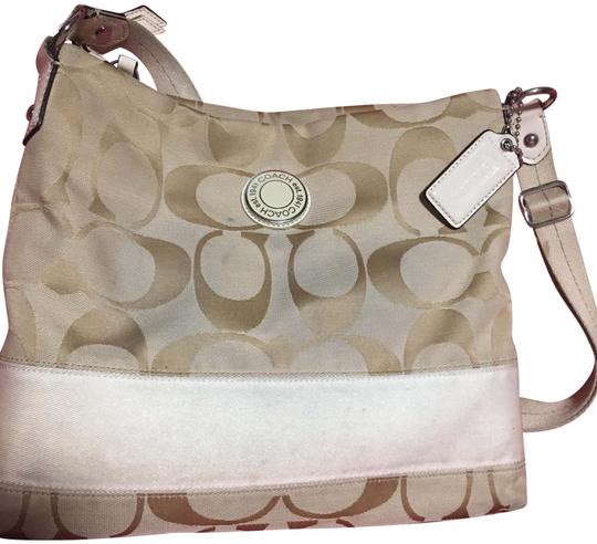 Preload https://item4.tradesy.com/images/coach-cc-beige-canvas-cross-body-bag-23007678-0-1.jpg?width=440&height=440