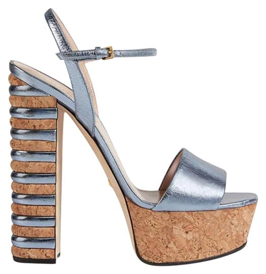 Preload https://item2.tradesy.com/images/gucci-bluesilver-metallic-leather-sandal-platforms-size-eu-375-approx-us-75-regular-m-b-23007816-0-1.jpg?width=440&height=440