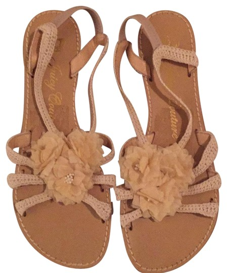 Preload https://item5.tradesy.com/images/juicy-couture-cream-sandals-size-us-9-regular-m-b-23008199-0-1.jpg?width=440&height=440
