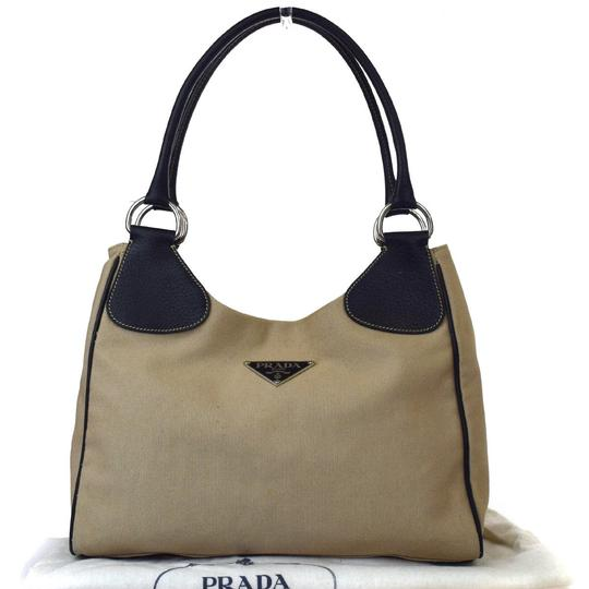 Preload https://img-static.tradesy.com/item/23008340/prada-beige-canvas-shoulder-bag-0-0-540-540.jpg