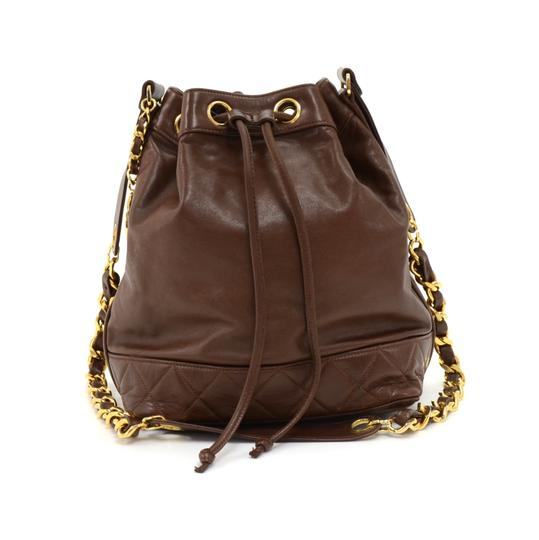 Preload https://item2.tradesy.com/images/chanel-drawstring-vintage-bucket-pouch-brown-lambskin-leather-shoulder-bag-23008586-0-0.jpg?width=440&height=440