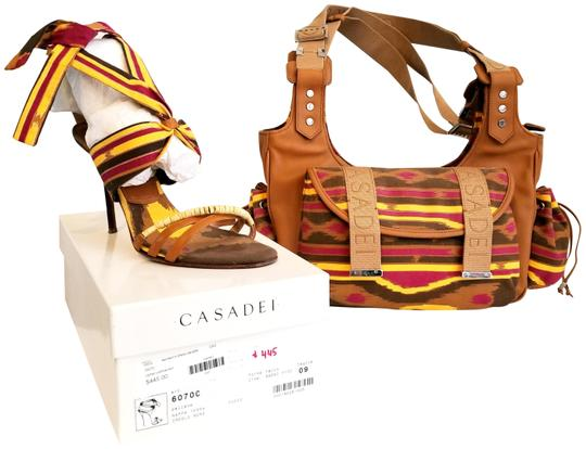 Preload https://item4.tradesy.com/images/casadei-monogram-multi-color-fabric-canvas-and-leather-satchel-23008598-0-3.jpg?width=440&height=440