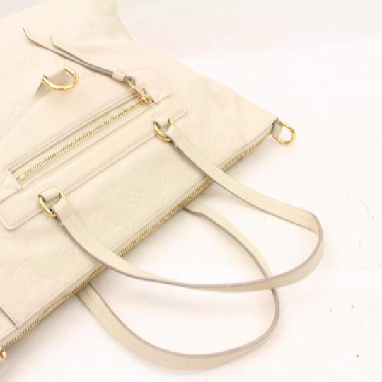 Louis Vuitton Artsy Neverufll Totally Leather Lv Empreinte Lv Tote in Whites