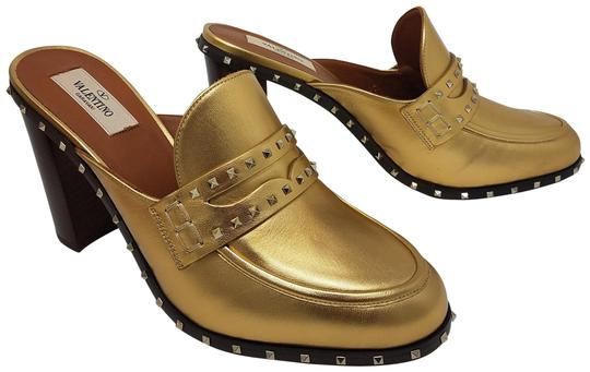 Preload https://item3.tradesy.com/images/valentino-gold-metallic-gold-tone-leather-penny-loafer-mulesslides-size-eu-38-approx-us-8-regular-m--23008912-0-3.jpg?width=440&height=440