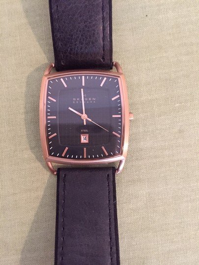Skagen Denmark Skagen Black Leather Watch with brass color stainless steel case, has date function