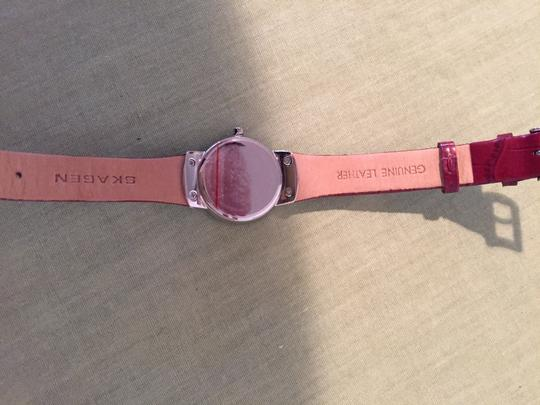 Skagen Denmark Skagen Red Leather womans watch with silver hardware and cystals.