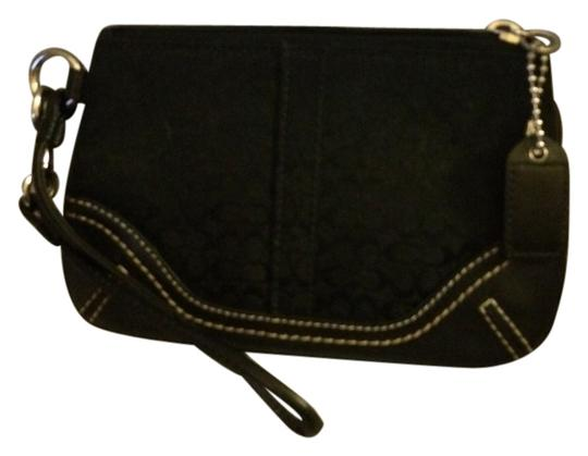Preload https://item4.tradesy.com/images/coach-black-signature-coated-canvas-clutch-2301908-0-0.jpg?width=440&height=440