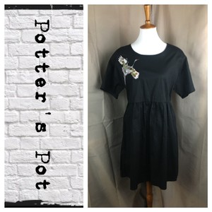 Potter's Pot short dress Black on Tradesy