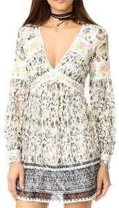 Free People short dress Longsleeve Floral V-neck Print on Tradesy