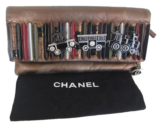 Preload https://item4.tradesy.com/images/chanel-clutch-rare-collectors-train-surf-board-metallic-clutch-2303438-0-0.jpg?width=440&height=440