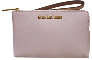 ba96cb169f074a Michael Kors Clutches - Up to 70% off at Tradesy