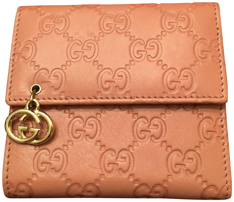 851414c9f4d Gucci Pink Guccissima Trifold Monogram Leather Gucci Wallet Image 0 ...
