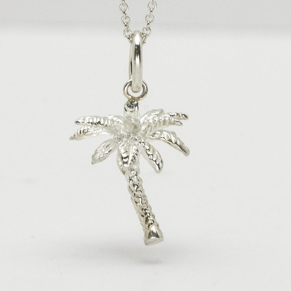 09bb1f84e Tiffany & Co. Silver Palm Tree Charm Pendant On 18