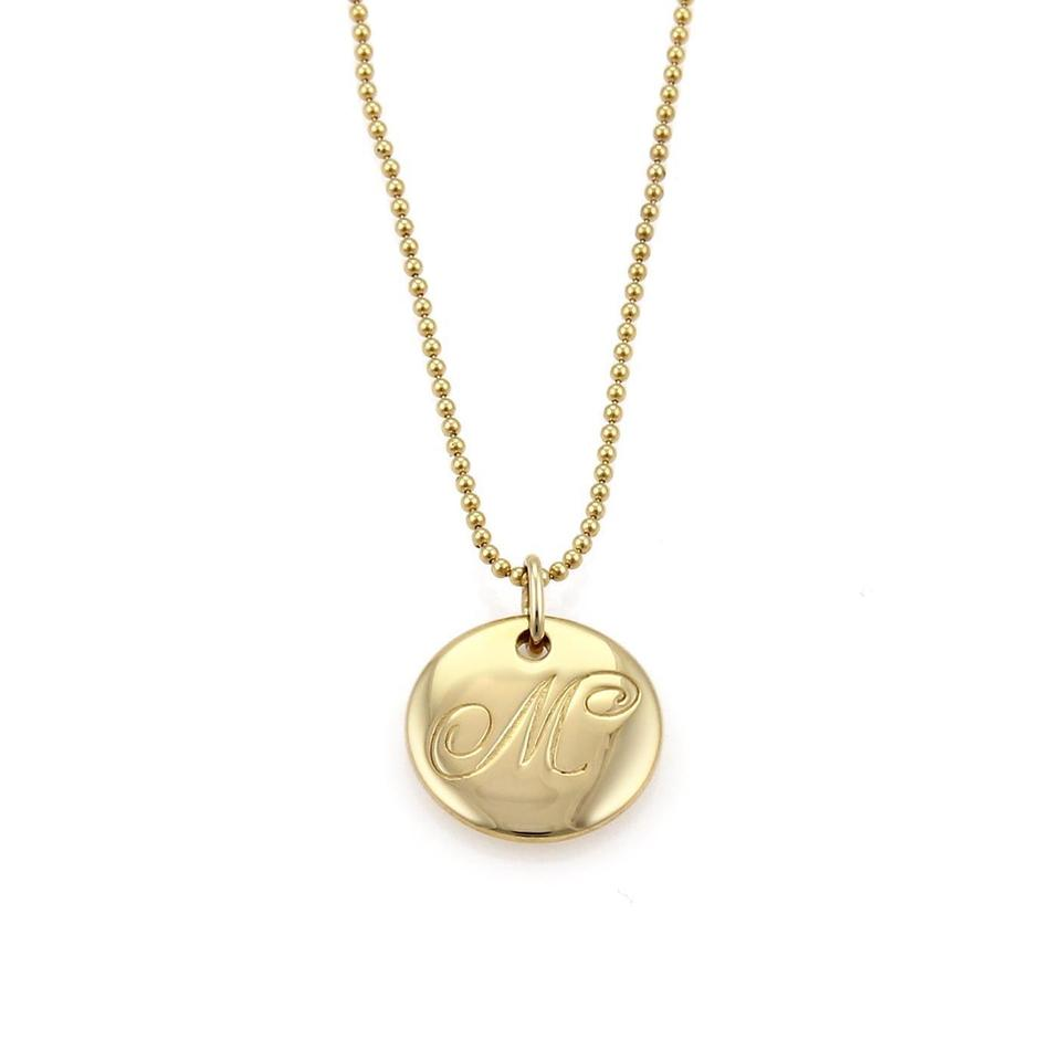 Tiffany co 19506 notes letter m 18k yellow gold disc pendant tiffany co aloadofball Gallery