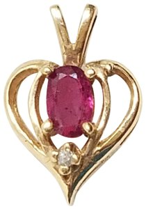 Gold 10k yellow ruby diamond accent heart pendant charm tradesy unbranded 10k yellow gold ruby diamond accent heart pendant aloadofball