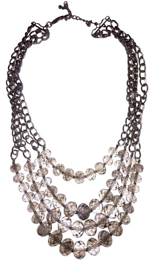 Preload https://item4.tradesy.com/images/clear-multi-strand-beaded-necklace-2306113-0-0.jpg?width=440&height=440