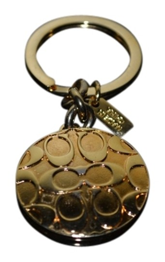 Preload https://item3.tradesy.com/images/coach-gold-tone-locket-charm-2306632-0-0.jpg?width=440&height=440