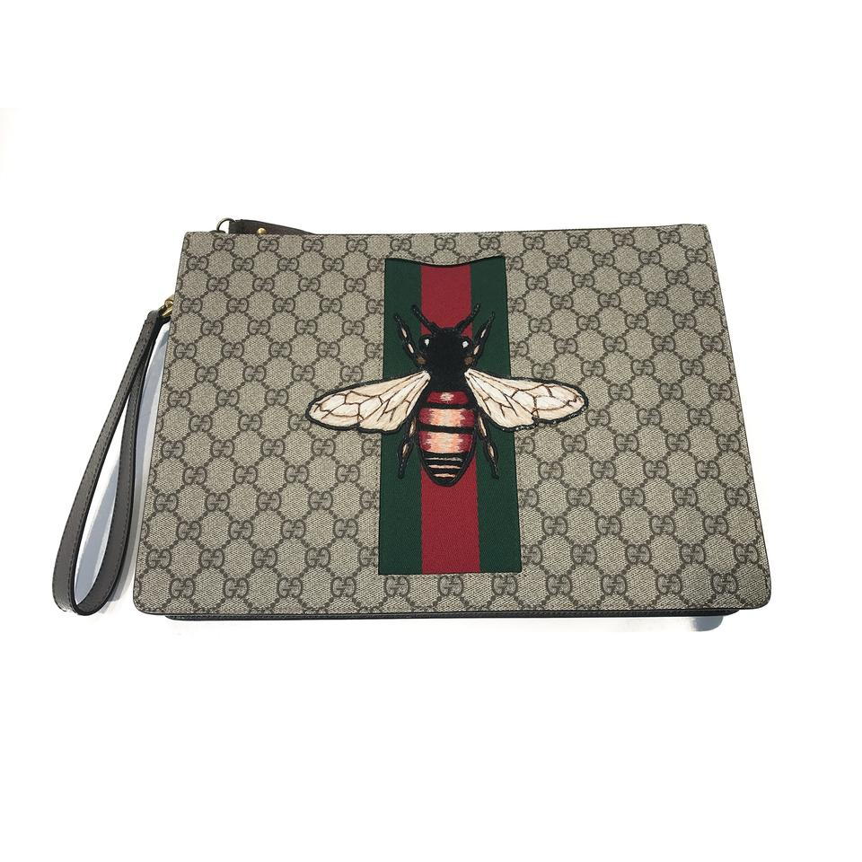 55c4497656b Gucci Gg Supreme Bee Portfolio Pouch Brown Canvas Clutch - Tradesy