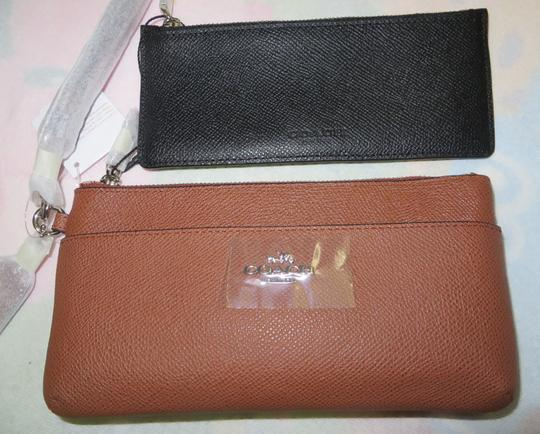 Preload https://img-static.tradesy.com/item/2307196/coach-with-removable-pouch-ship-via-priority-mail-wristlet-wallet-0-0-540-540.jpg