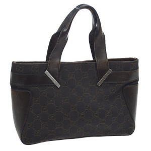 Gucci Satchel/Tote Style Perfect For Everyday Has Dust Mint Condition Black/Brown Tote in black canvas with brown large G logo priint & brown leather