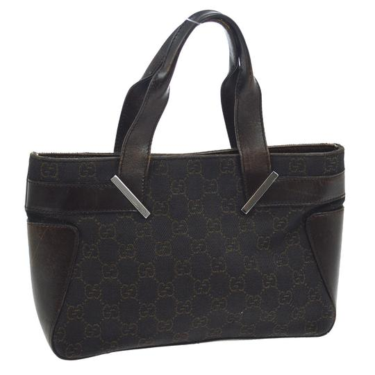 Preload https://img-static.tradesy.com/item/23073268/gucci-pursesdesigner-purses-black-canvas-with-brown-large-g-logo-priint-and-brown-leather-tote-0-0-540-540.jpg