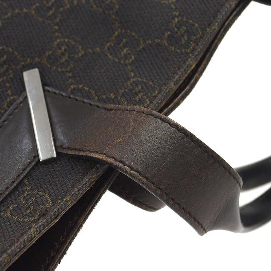 Gucci Satchel/Tote Style Perfect For Everyday Has Dust Mint Condition Black/Brown Tote in black canvas with brown large G logo priint & brown leather Image 5