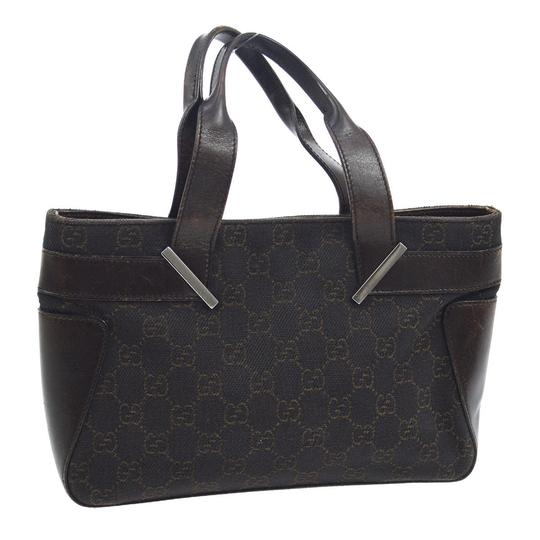 Gucci Satchel/Tote Style Perfect For Everyday Has Dust Mint Condition Black/Brown Tote in black canvas with brown large G logo priint & brown leather Image 6