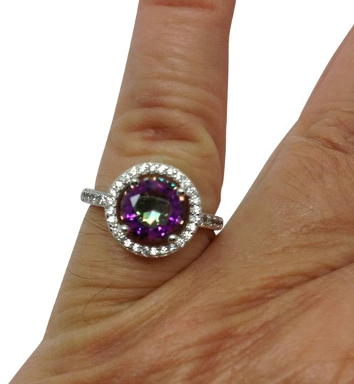 Preload https://img-static.tradesy.com/item/23073310/925-over-silver-plated-synthetic-mystic-topaz-cz-halo-ring-0-1-540-540.jpg