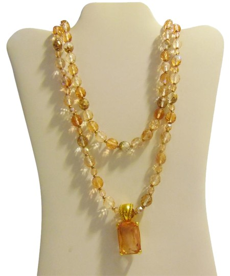 Preload https://item5.tradesy.com/images/joan-rivers-goldtone-2-strand-beaded-necklace-2307544-0-1.jpg?width=440&height=440