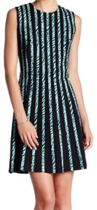 BCBGMAXAZRIA short dress Super_Quality Lined Printed Band Overlay V-neck Sleeveless Structured on Tradesy