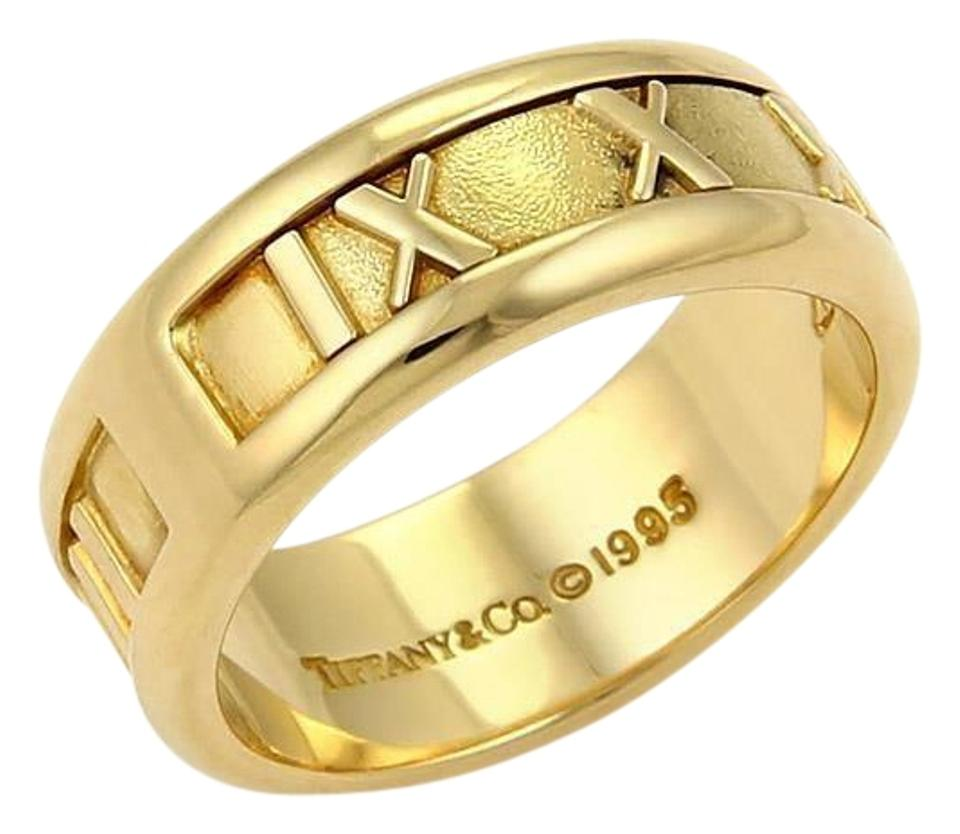 8adc8c952 Tiffany & Co. Atlas Roman Numeral 18k Yellow Gold Band Ring Image 0 ...