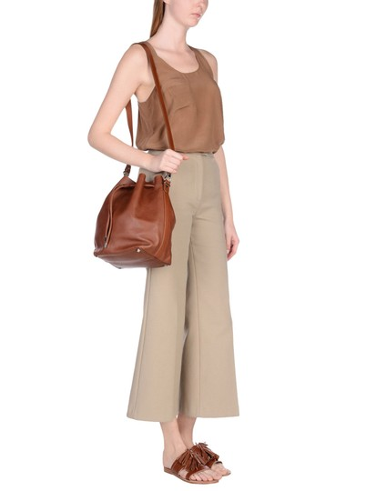 Preload https://img-static.tradesy.com/item/23093586/proenza-schouler-medium-bucket-tan-leather-cross-body-bag-0-0-540-540.jpg