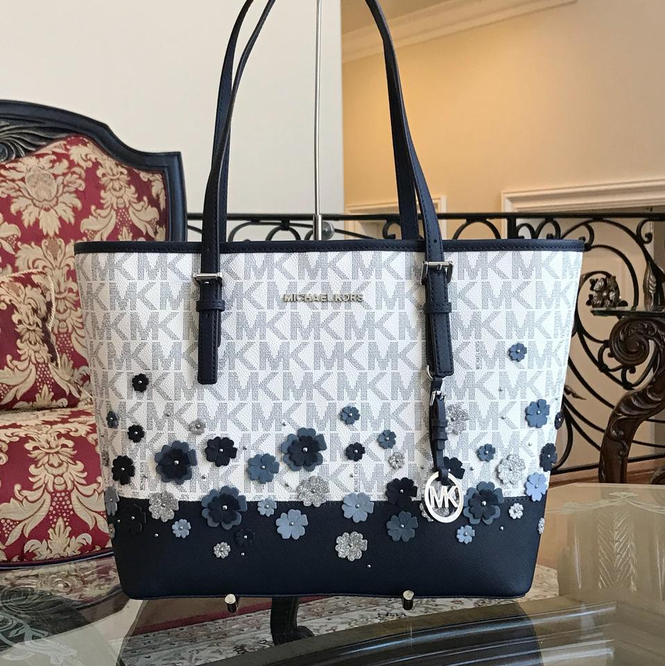 d5a2dbdf9e50 Michael Kors Leather Flower Carryall Tote in navy/white Image 0 ...