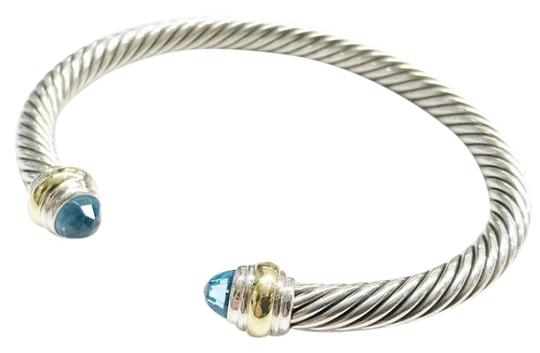 Preload https://item4.tradesy.com/images/david-yurman-never-worn-14k-and-sterling-silver-blue-topaz-cable-bangle-bracelet-23101918-0-1.jpg?width=440&height=440
