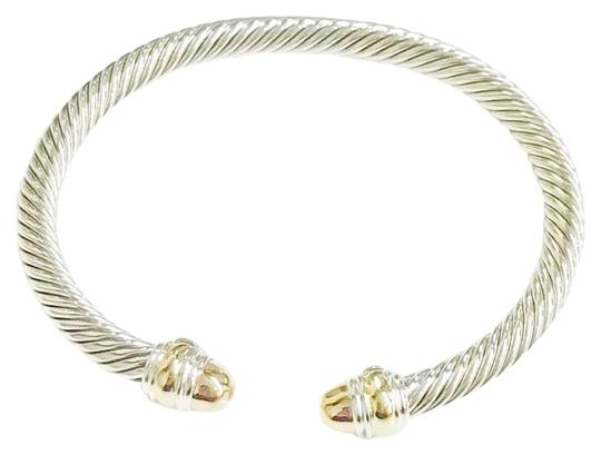 Preload https://item1.tradesy.com/images/david-yurman-never-worn-14k-yellow-gold-and-sterling-silver-cable-bangle-bracelet-23102145-0-1.jpg?width=440&height=440